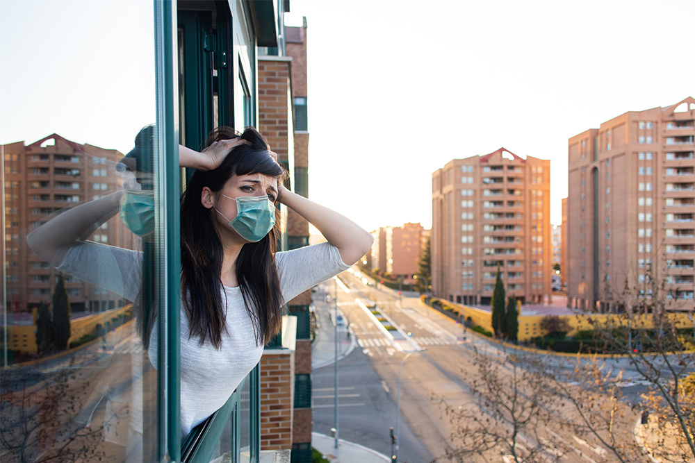 [insert an image of condominiums with people wearing face masks]